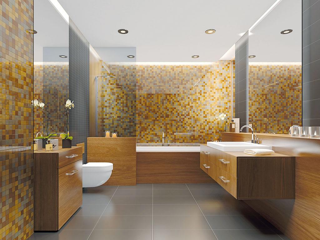 Modernes Badezimmer mit gold, grau und warmen Fliesen